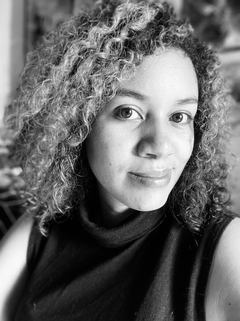 Joanna Chin biography photo mixed race woman with curly hair and big brown eyes