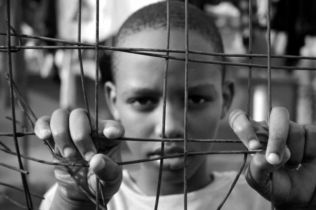 child behind fence