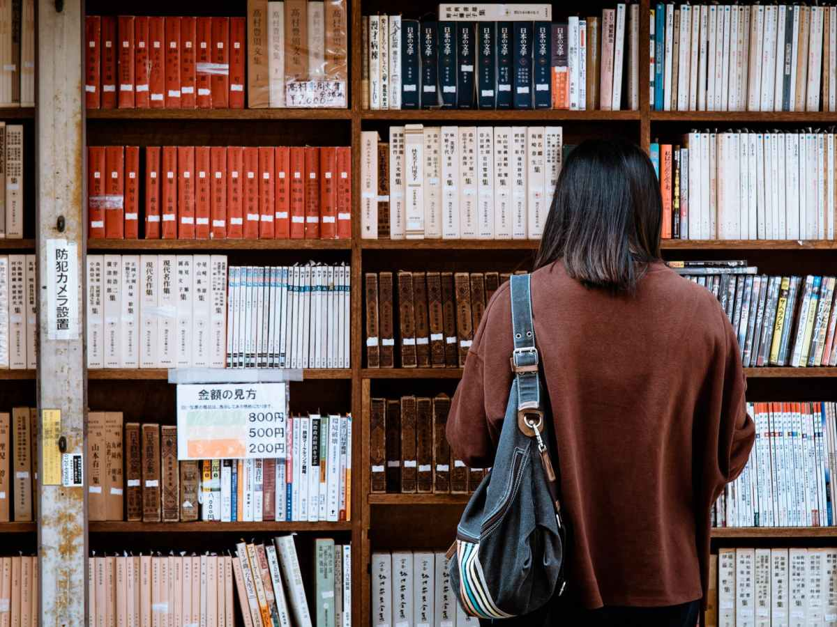 Women looking at books on a shelf