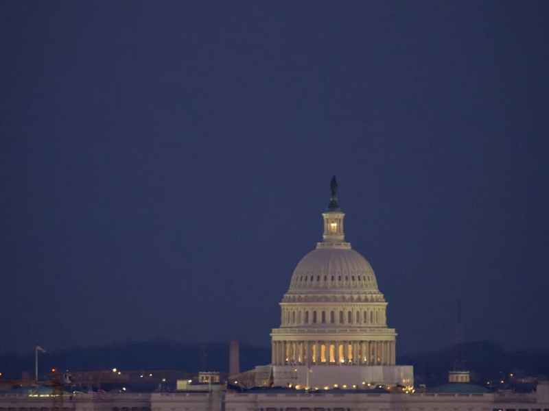 United States capitol under the evening moon.