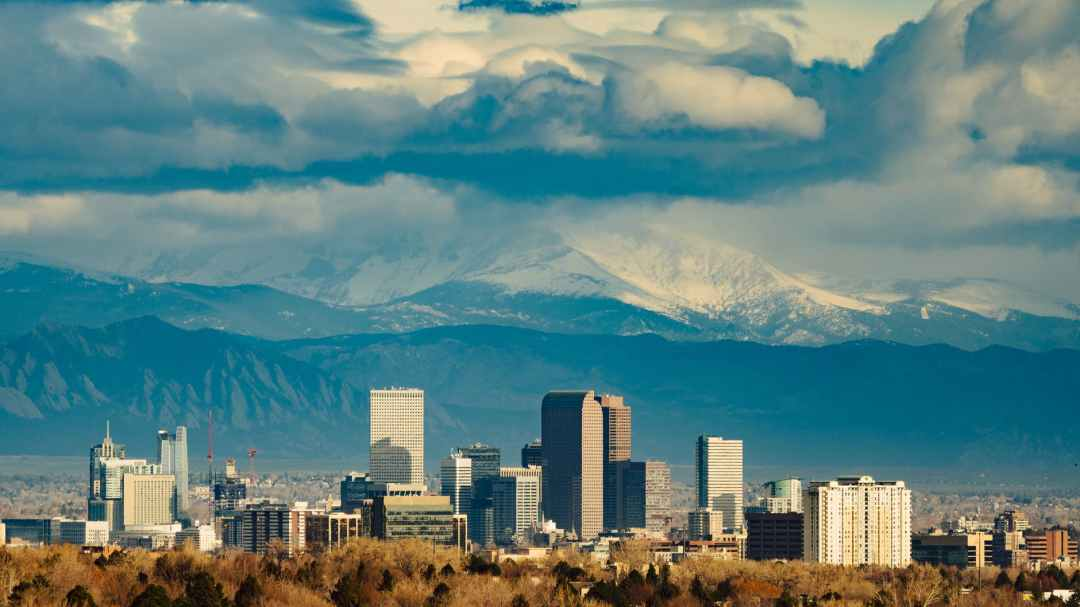 Denver skyline against the mountains